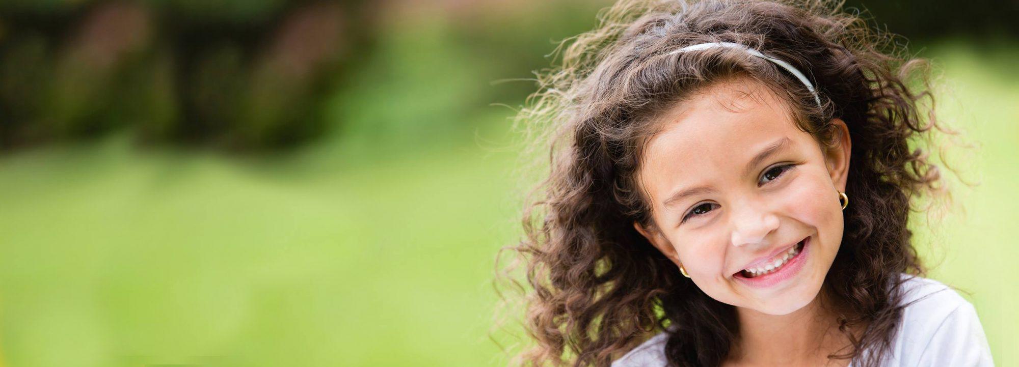 Smiling little girl at Montessori Kids Universe school